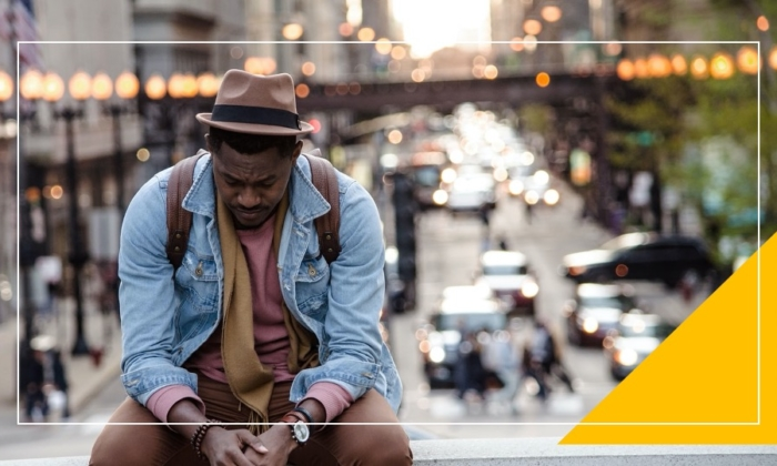 Man sitting near a street
