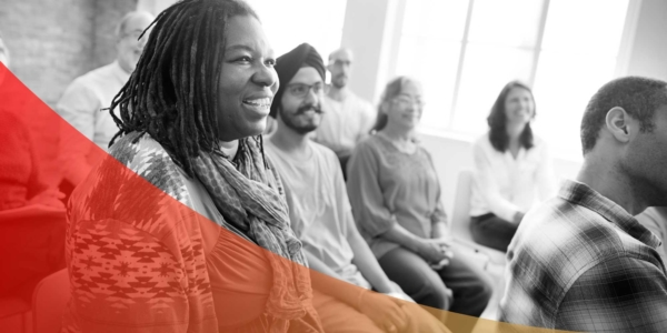 Group of people smiling during diversity and inclusion training